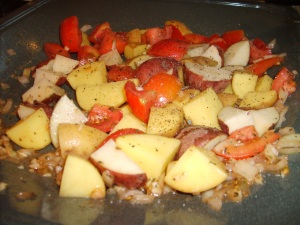 White and Red Spuds, Quartered Tomatoes, Spices and Yum.